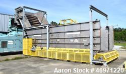 "Used- Inclined Feedstock Conveyor Feeder, Approximate 120"" Wide. Stainless steel bottom side panels approximate 8' tall, car..."