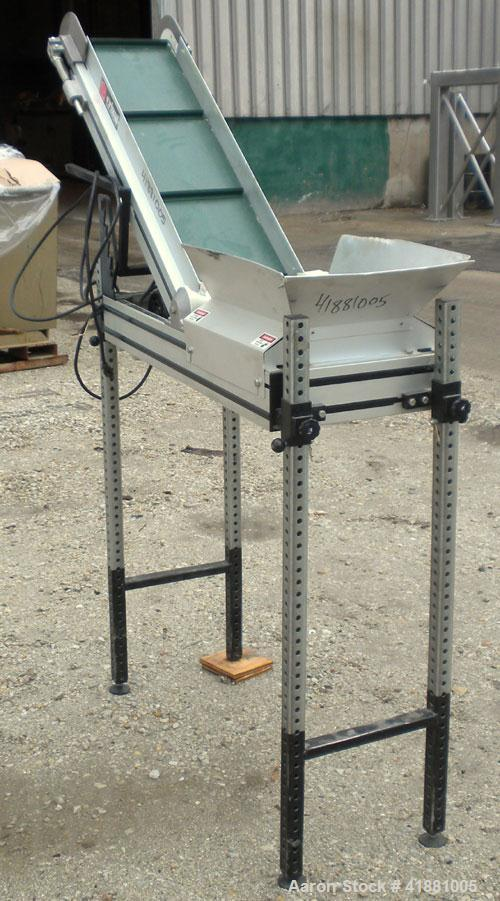 "Used- Crizaf Incline Belt Conveyor, Model LTCH/1-0510. 10"" wide x 12"" horizontal section x 40"" incline section. Driven by a ..."