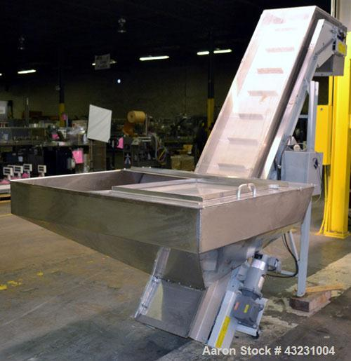 "Used- Bulk Elevator Feeder, Stainless Steel. Approximate 10"" widex 84'' long pleated belt, approximate 80"" discharge height...."