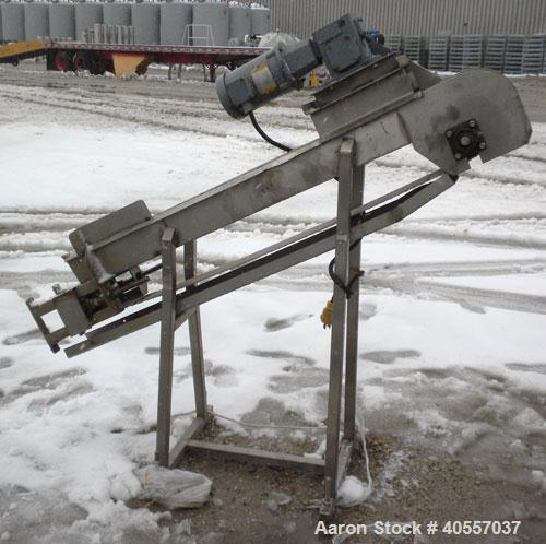 "Used- Incline Belt Conveyor. 6"" wide x 56"" long cleated rubber belt. Driven by a 3/4 hp, 3/60/208-230/460 volt, 1725 rpm gea..."