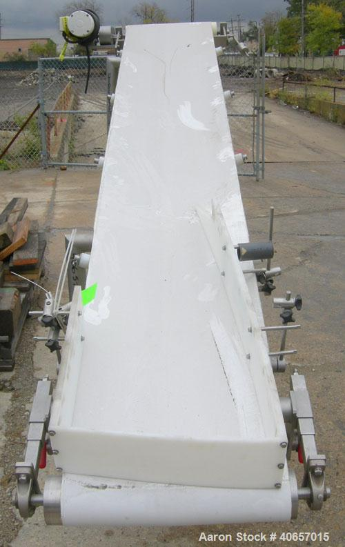 """Used- Inclined Belt Conveyor, 23 1/2"""" wide x 152"""" long rubber belt. Driven by a 1 hp, 3/60/208-230/460 volt, 1725 rpm gearmo..."""