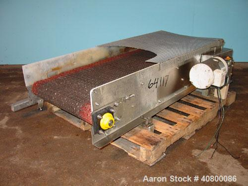 "Used- Belt Conveyor. Plastic belt 24"" wide x 53"" long. Stainless steel frame. Driven by a 1 hp, 3/60/575 volt, 1725 rpm gear..."