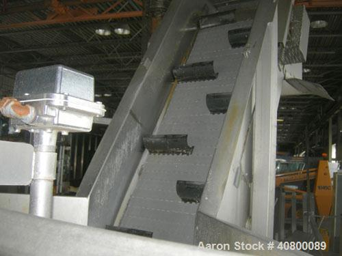 "Used- Inclined Plastic Belt Conveyor. 18"" wide x 96"" long with 9"" wide x 3"" tall offset pockets. 301 stainless steel supply ..."