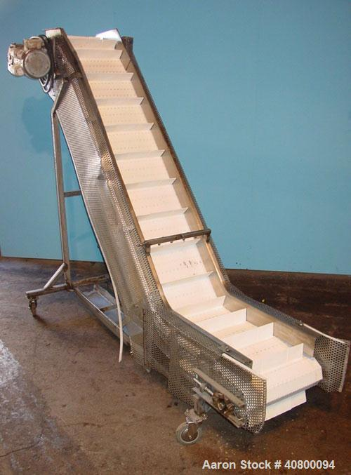 """Used- Inclined """"S""""ShapedConveyor, 304 stainless steel frame.14"""" wide x 3"""" tall cleated plastic belt,24"""" long bottom infe..."""