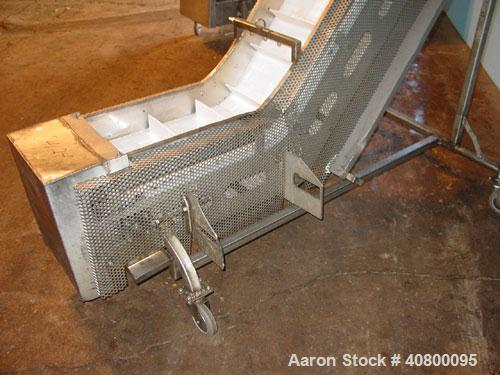 "Used- Inclined ""S"" Shaped Conveyor, 304 stainless steel frame. 12"" wide x 3"" tall cleated plastic belt, 24"" long bottom infe..."
