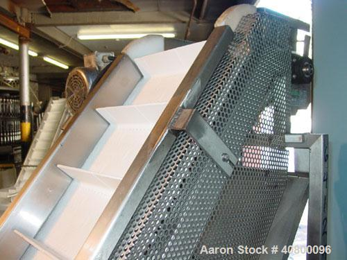 "Used- Trio-Pac Inclined ""S"" Shaped Conveyor, 304 stainless steel frame. 14"" wide x 3"" tall cleated plastic belt, 24"" long bo..."