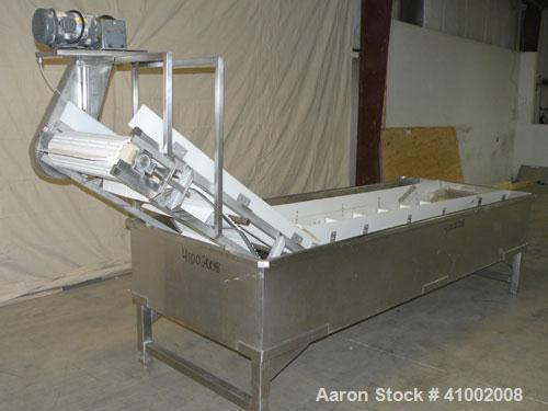 "Used- Inclined Plastic Submerged Belt Conveyor, 304 Stainless Steel. 24"" wide x 90"" long submerged section x 48"" long inclin..."
