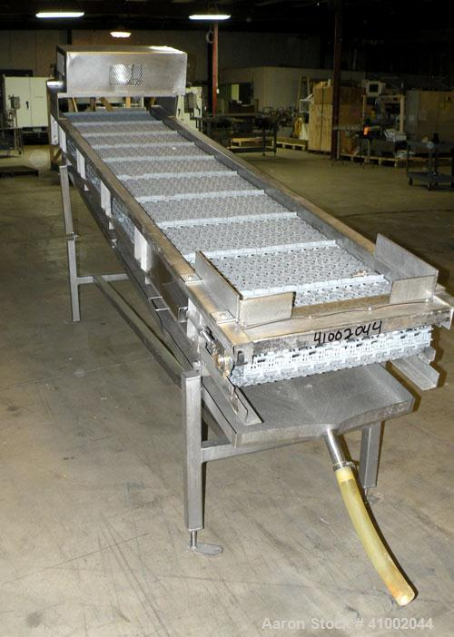 "Used- Ron Bichel Inclined Plastic Belt Conveyor. 24"" wide x 116"" long with 11 1/2"" wide x 1/2"" tall pockets. Driven by a 3/4..."