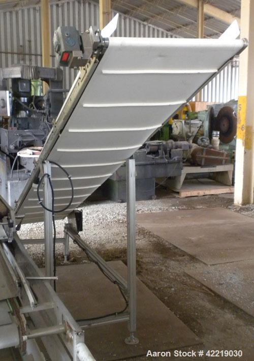 "Used- QC Industries Inclined Belt Conveyor, carbon steel. 21"" wide x 140"" long rubber belt, 12"" long pockets. 74"" discharge ..."