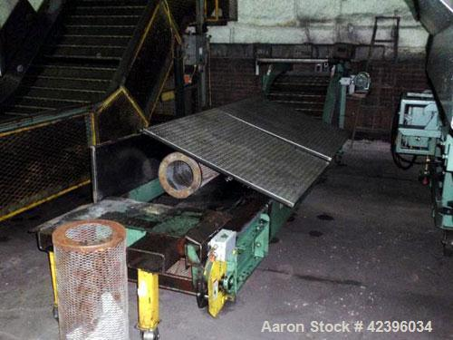 "Used- Z Style Metal Cleated Belt Conveyor. 28"" Wide x 7' long flat section, 3' long inclined section, 3' flat section. Appro..."