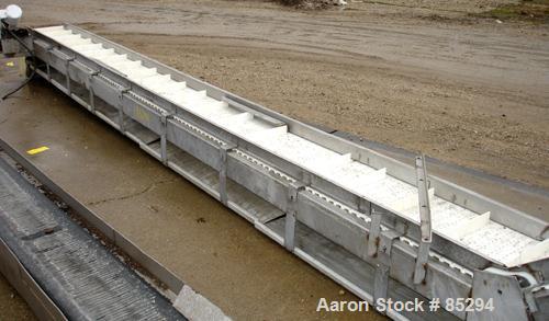 "Used- Incline Belt Conveyor, 304 stainless steel frame. Plastic belt 18"" wide x 48"" long bottom section x 140 degree 20' lon..."