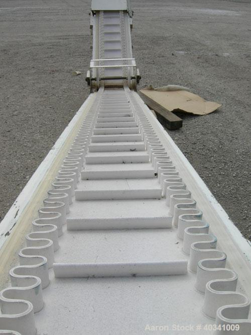 "Used- Rapat Corp ""S"" shaped flexwall incline conveyor, model FLX21.516. Carbon steel frame, approximately 12"" wide cleated r..."