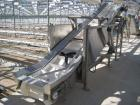 Used- Incline conveyor 20 inch wide x 14 feet long to 6 foot high elevation with air cylinder to raise and lower the infeed ...