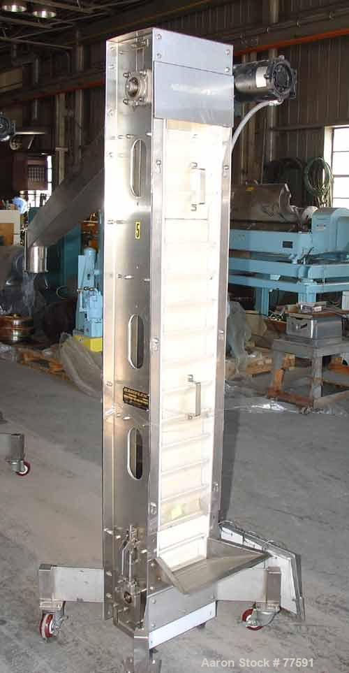 "Used- Kamflex Design Vertical Belt Conveyor. 10"" Wide x 7'7.58"" long rubber belt with 10"" wide x 1-1/2"" deep pockets, 43"" di..."