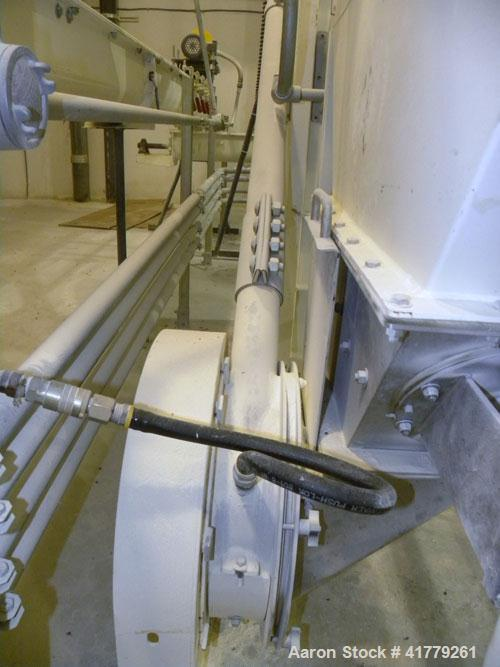 Used- Aerocon Puck Conveyor. Approximate capacity up to 10 cubic feet per minute. Driven by a 1.5hp XP gear motor. Built 200...