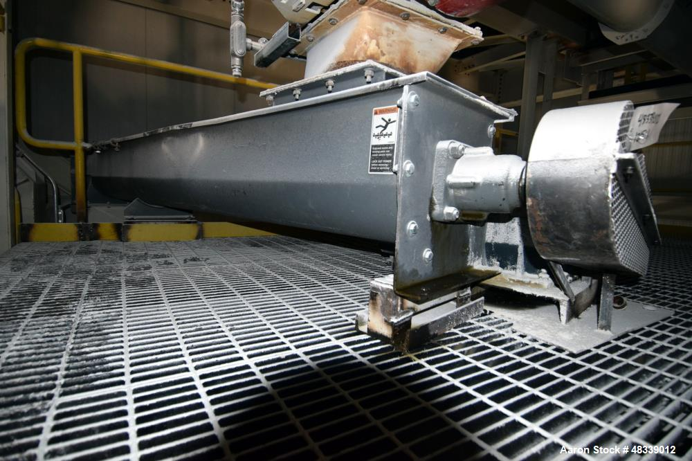 "Used- Kaman Screw Conveyor, Carbon Steel. Approximate 12"" diameter x 120"" long screw. Driven by a gear motor."
