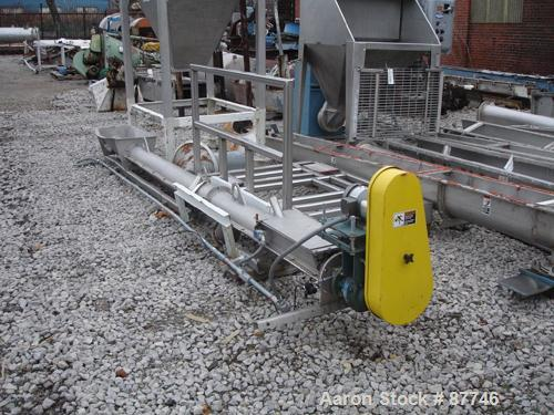 "USED: Inclined screw conveyor, stainless steel. 6"" diameter x 14' long screw. 8"" diameter x 14' long enclosed tube with a fe..."