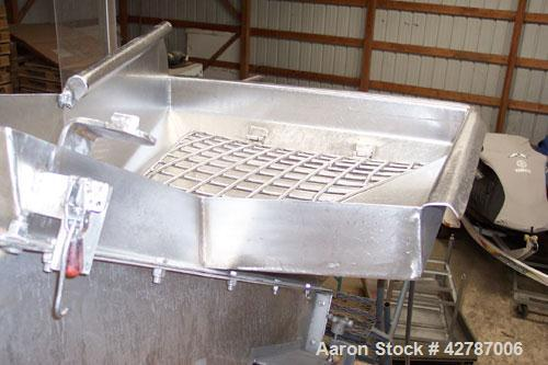 "Used- Inclined Screw Conveyor, 304 Stainless Steel. 9"" Diameter x 101"" long x 2'' pitch screw. 10'' Wide trough with (1) sec..."