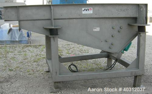 "Used- JVI vibratory conveyor, Model FUF1000X600X200X2150, stainless steel. Tapered bed 39 1/2"" wide to 24"" wide x 7' long. 3..."