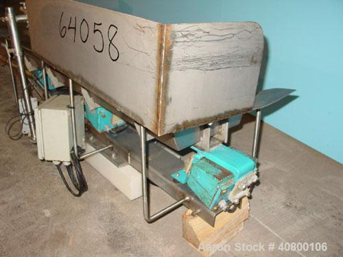Used- H Tech Vibratory Conveyor, Stainless Steel. 10-1/2'' Wide x 74'' long x 3'' high sides vibrating pan. Syntron speed co...