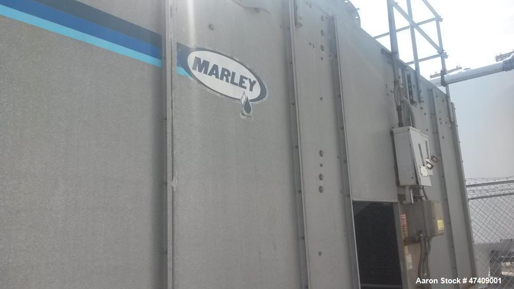 Used- Marley Cooling Tower. Approximately 17' long x 8' wide. 7' fan with 6 adjustable blades driven by 20HP. 460VAC, 3Ph mo...