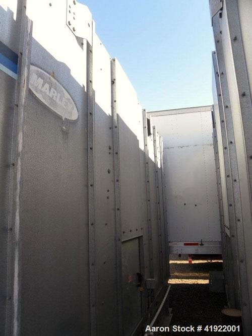 Used- Marley NC Class Crossflow Cooling Tower, 291 nominal tons, model NC3021GM. Galvanized steel housing. Fan driven by a 2...