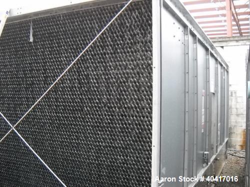 Used-Marley Cooling Tower, 833 Ton Capacity.  Hot and cold basins are stainless steel.  Built in 2004.