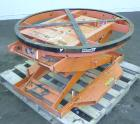 Used- Presto Pallet Positioner, Model P3, Carbon Steel. 4,500 Pound capacity pallet lift, platform diameter 43-5/8