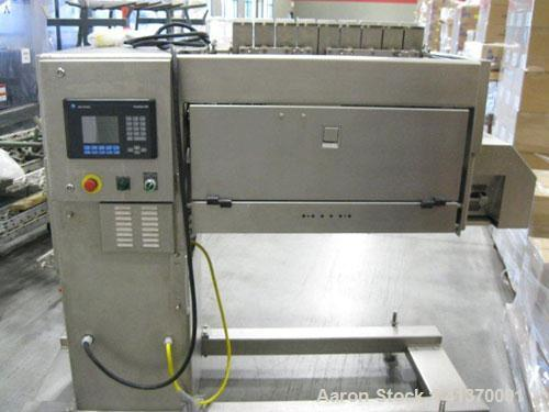 Used-Grote S/A-530E Slicer is designed of stainless steel construction and is cantilevered to roll directly over a belt conv...