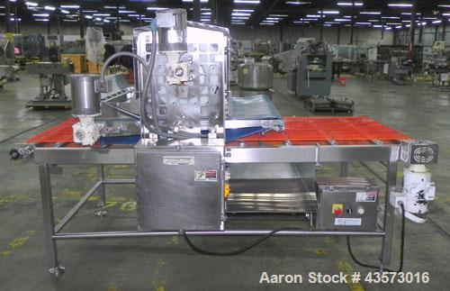 Used- Quantum Model WF3000 Waterfall Toppings Applicator. Rated at speeds up to 80 feet of product per minute. Has an innova...