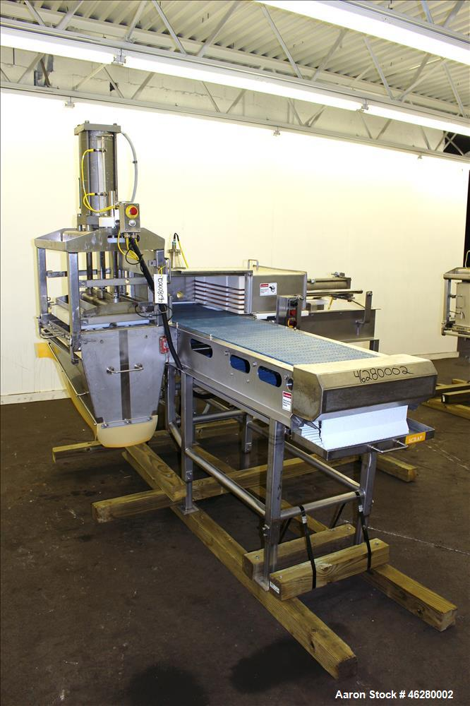 Used- Marchant Schmidt Pneumatic Cheese Cubing Machine, Model MS80. Machine is rated at speeds up to 10,000 pounds per hour....
