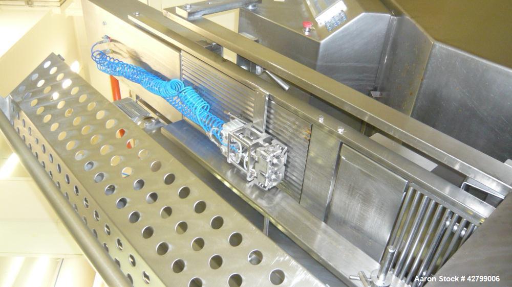 Used- Weber Cutting Line. (1) Used Weber cutter. Model 9000. Built 1994. (2) Conveyor.