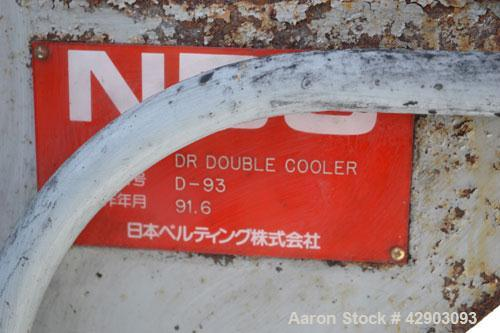 "Used-NBC Double Belt Cooler, Model DR. (2) 17-3/4"" Wide x approximate 116"" long stainless steel belts. Each belt mounted on ..."