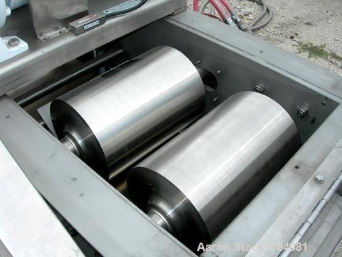 "Used- Sandvik Belt Cooler, 316 Stainless Steel. 12"" Wide x 63"" long belt, on 24"" diameter cored rolls, driven by a 1/2 HP, 3..."