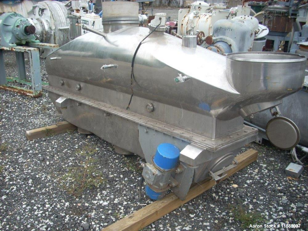 "Used- APV Anhydro fluid bed agglomerator. Stainless steel construction. With 12"" wide x 9' long perforated pan bed. Dual 2 K..."