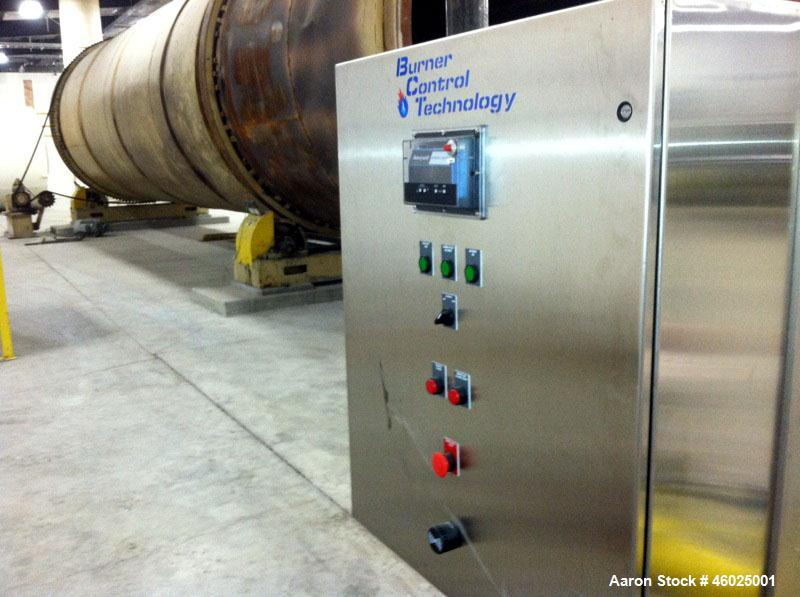 Used- DUPPS Quad / 4 Pass Dryer, Carbon steel, 12' diameter x 52' long. Rated 50MM BTU biomass burner. Natural gas fired.