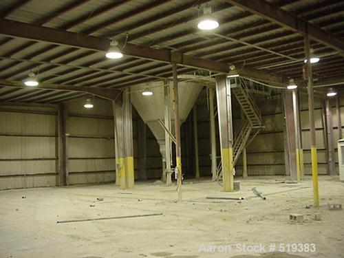 USED: Sacmi spray dryer, model ATM 36. Approximately 14' diameter x20' high with 10' cone. Still installed inside. Year 1999.