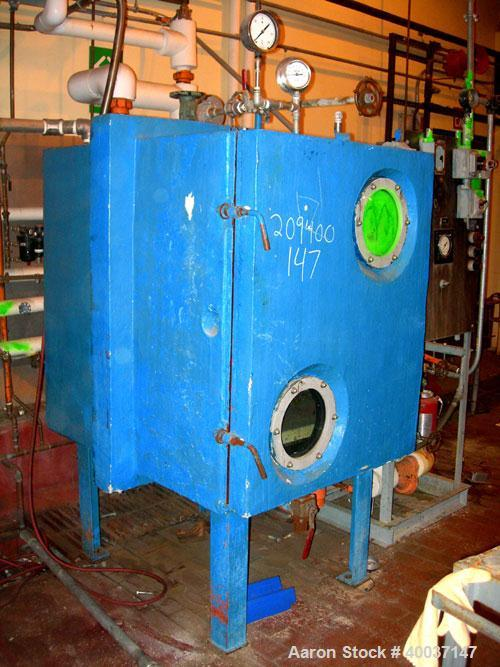 "Used-USED: Stokes vacuum shelf dryer. Model 338-3.Approximately 30 square feet. (7) 24"" wide x 36"" deep x 1"" thick stainless..."