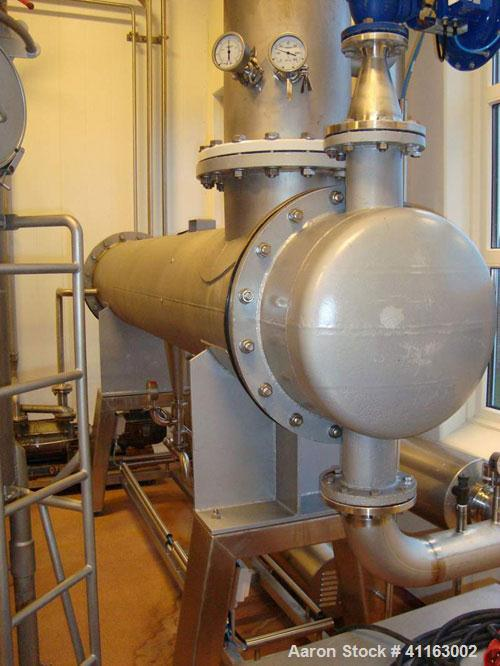 Used- APV 2 Stage Evaporator, Capacity Approximately 4400 lbs/hr (2000 Kg/hr) finished product consisting of: (2) APV evapor...