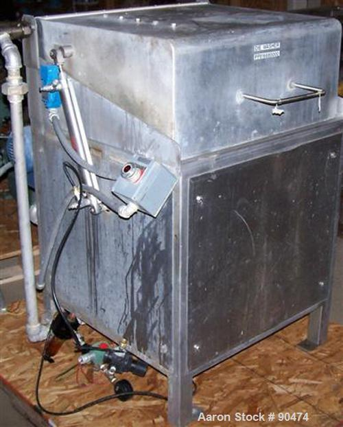 Used- Amberette Machinery Extruder. Approximately 6'' diameter x 48'' long Incoloy screw, driven by a 40 HP, 3/60/230/460 Vo...