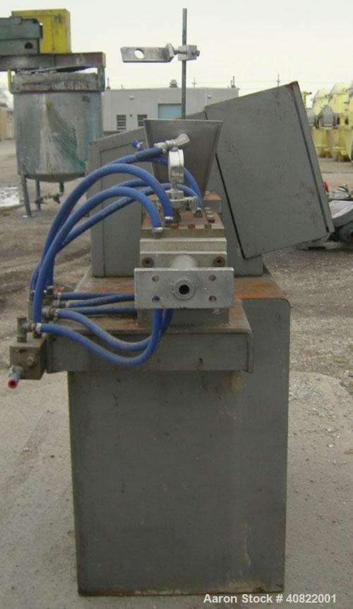 "Used- APV Baker Twin Screw Extruder, approximate 1"" diameter screws. Water heated and cooled barrel. Water cooled feed throa..."