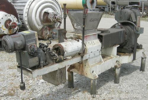 "Used-  Bonnot Extruder, Model 2209, Carbon Steel.  Approximately 4"" diameter x 28"" long screw.  Jacketed barrel.  7"" x 12"" f..."
