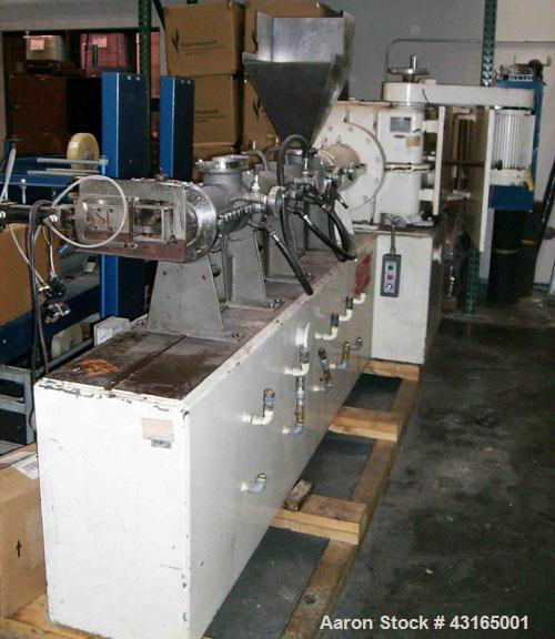 "Used-Buss Extruder, approximately 4"" diameter (200 mm), 10 hp, 3 ph, 240V fly knife cutter."