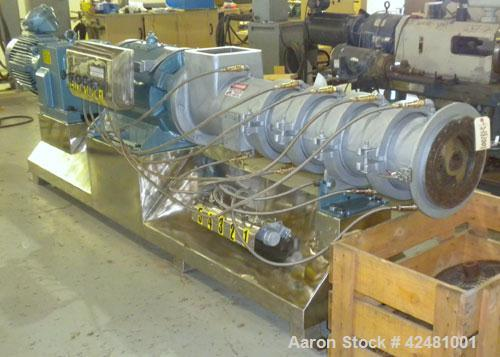 Used- Extru-Tech Inline Extruder, Model E750-PDU-PT03-EX-300. Approximately 10'' diameter 400 series stainless steel tapered...