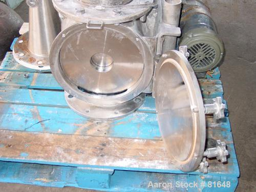 """USED: Young 12"""" rotary airlock, stainless steel. Approx 3/4 hp motor."""