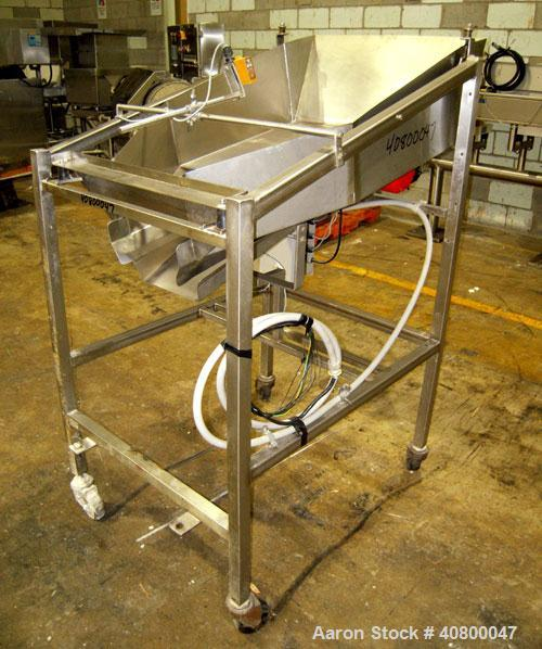 "Used-Vibratory Feeder, stainless steel. 26"" wide x 42"" long x 10"" deep tray. Mounted on a stainless steel frame with casters."