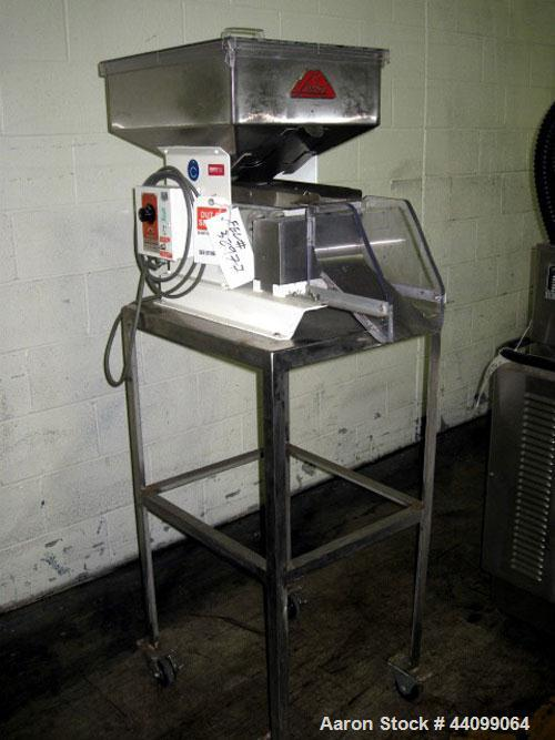 "Used- Lakso Vibratory Feeder, Model 64. With Eriez model D vibrator, 4""W chute, 15"" x 20"" hopper, on stainless steel stand, ..."