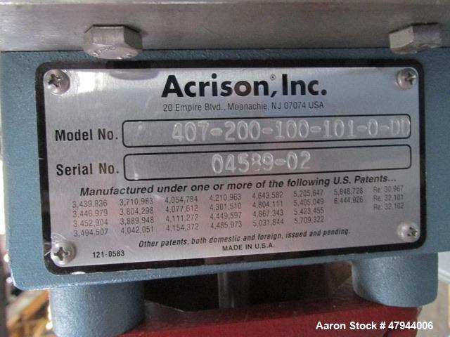 """Used- Acrison Loss In Weight Feeder, Model 407-200-100-101-0-00. Stainless steel construction, approximately 2"""" diameter x 9..."""