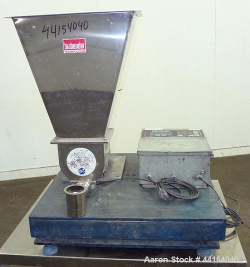 "Used- Brabender Technologie Twin Screw Feeder, 304 Stainless Steel. (2) Approximate 3/4"" diameter x 9"" long screws. Feed hop..."