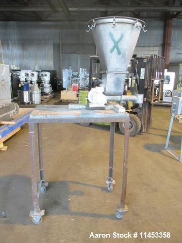 "Used- K-Tron Feeder, Model F-1. 2"" diameter x 24"" long screw. Stainless steel construction. Mounted on a carbon steel cart 5..."